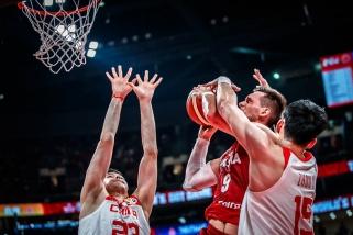 Lenkai per pratęsimą palaužė pasaulio čempionato šeimininkus